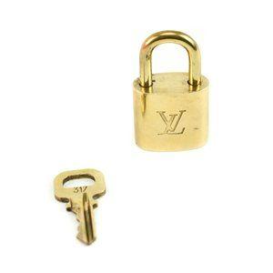 """LOUIS VUITTON: Gold/Brass, Metal """"LV"""" Padlock (ou)"""